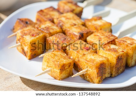Paneer Tikka Kebab - Tandoori Indian cheese skewers. Eating outdoors! - stock photo