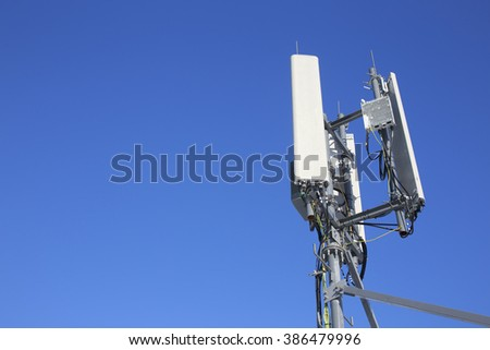 panel antenna mobile communication on background blue sky. telecommunications antenna tripod on the tower. cellular communications 2g, 3g, GSM, LTE. bottom view. copy space for your text - stock photo