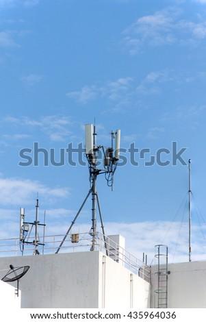 panel antenna mobile communication on background blue sky. telecommunications antenna tripod on the tower. - stock photo
