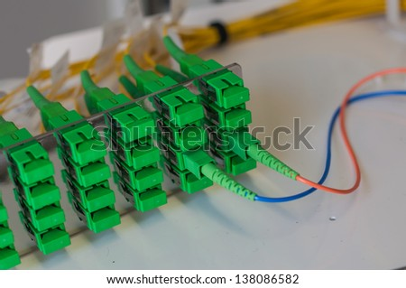 Panel of Fiber network switch with fiber optic  network cables - stock photo