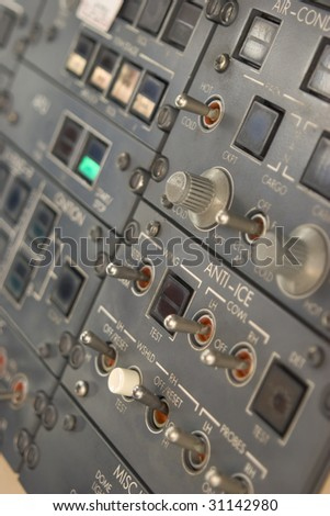 Panel of switches on an aircraft flight deck - stock photo