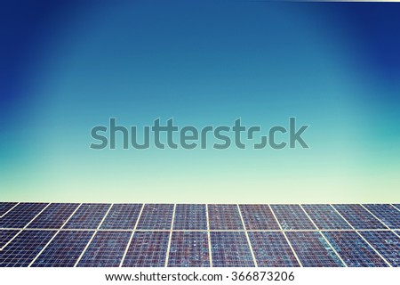 Panels of solar power station on the field - stock photo