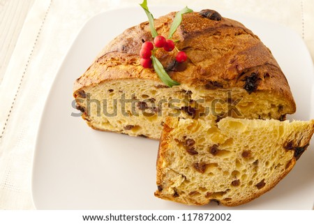 Panettone, a typical Christmas cake on a plate