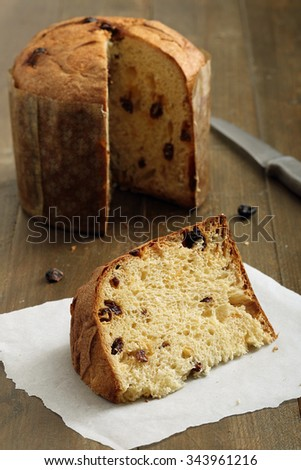 panettone sweet  cake on rustic table background - stock photo