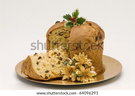 Panettone.Traditional italian Christmas cake filled with raisins and candied orange peels. - stock photo
