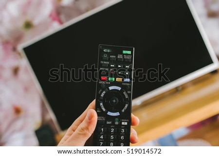 PANEVEZYS, LITHUANIA - NOVEMBER 20, 2016: Hand holding a remote tv control, smart television