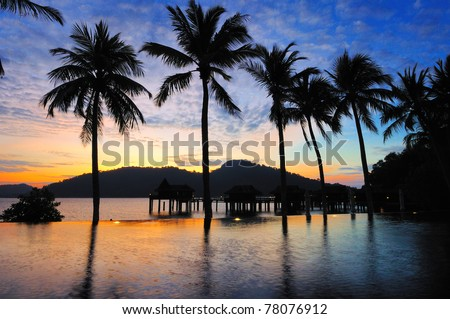 Pangkor Laut, an island of the coast of Peninsular Malaysia, well known for its Villas on stilts and spectacular sunrise - stock photo