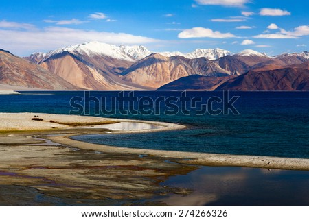 Pangong Lake in Ladakh, Jammu and Kashmir State, India. Pangong Tso is an endorheic lake in the Himalayas situated at a height of about 4,350 m. It is 134 km long and extends from India to Tibet. - stock photo