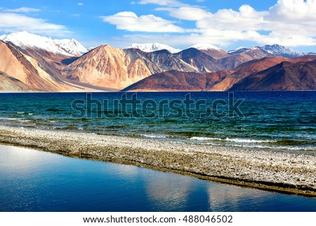 Pangong Lake in Ladakh, North India. Pangong Tso is an endorheic lake in the Himalayas situated at a height of about 4,350 m. It is 134 km long and extends from India to Tibet