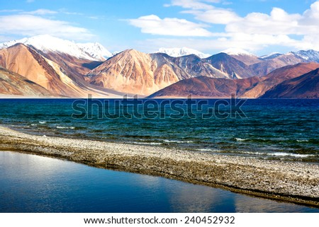 Pangong Tso Lake in Ladakh, Jammu and Kashmir State, India. Pangong Tso is an endorheic lake in the Himalayas situated at a height of about 4,350 m. It is 134 km long and extends from India to Tibet. - stock photo