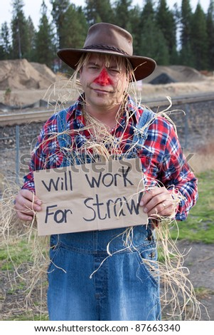 Panhandling scarecrow - stock photo