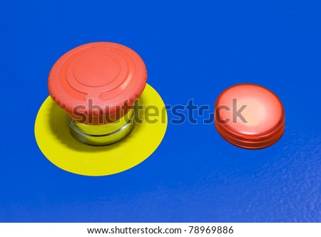 Panic alert button isolated on blue background