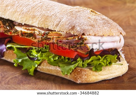 panini sandwich with lettuce tomato and turkey - stock photo