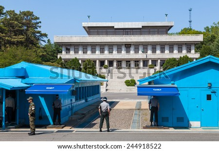 PANMUNJOM, SOUTH KOREA - MAY 9, 2014: Korean soldiers watching border between South and North Korea in the Joint Security Area (DMZ) on May 9, 2014 in Panmunjom, South Korea. - stock photo