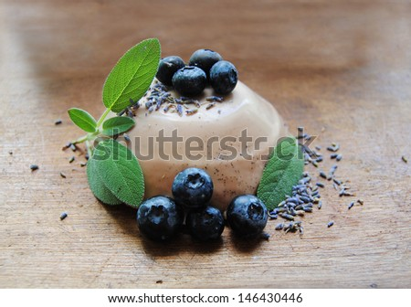 Panna Cotta whit Salvia, Lavender and Bilberries - stock photo