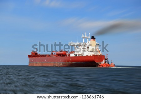 Panning photo with a tanker on the sea. - stock photo