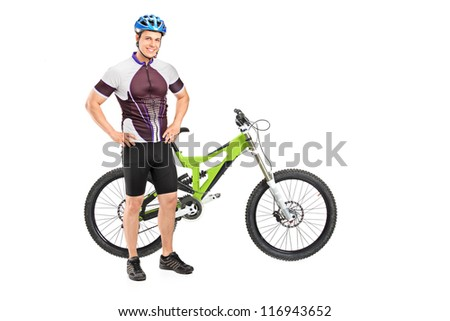Panning shot of a person riding a bike outdoors with some motion blur shot with a tilt and shift lens - stock photo