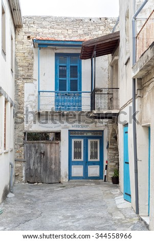 PANO LEFKARA, CYPRUS   MAY 1: View on workshop and art gallery entrance in dead end street and houses with lattice windows on May 1, 2015 in Pano Lefkara.