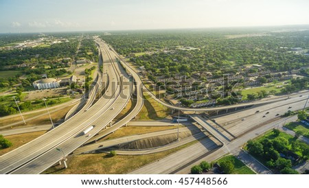 Panorama aerial view massive interstate I69 highway intersection, stack interchange with elevated road junction overpass in downtown Houston. This five-level freeway interchange carry heavy traffic.