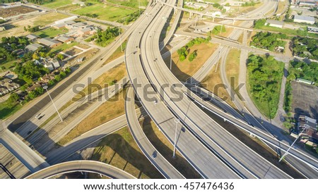 Panorama aerial view massive interstate I69 highway intersection, stack interchange with elevated road junction overpass in downtown Houston. This five-level freeway interchange carry heavy traffic. - stock photo