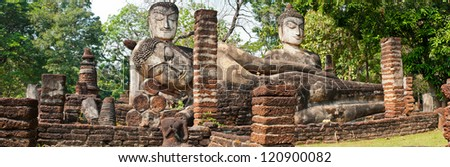Panorama Ancient buddha statue in historical park, Kamphaengphet province, Thailand. - stock photo