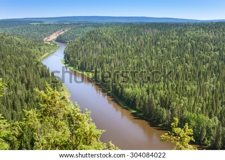 Panorama bend of the river among the green forest aerial photo - stock photo