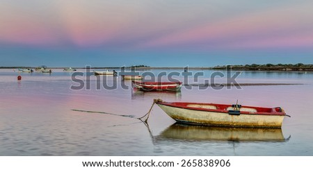 Panorama harbor with fishing boats on a pink sunset. - stock photo