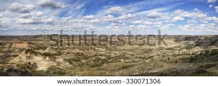 Panorama image of the badlands of Theodore Roosevelt National Park.  Medora, North Dakota - stock photo
