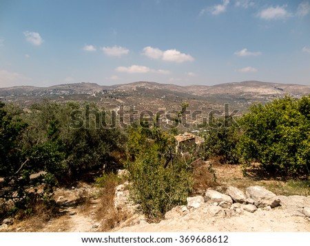 Panorama land around Sebastia in Samaria, Israel. Olive trees and other, shrubs, buildings - stock photo