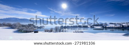 panorama landscape in Bavaria nearby alps mountains in winter - stock photo