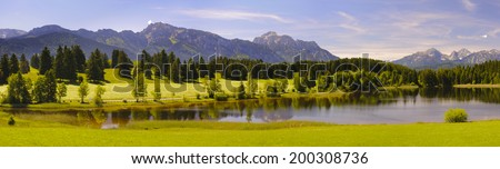 panorama landscape in Bavaria with lake and alps mountains at spring - stock photo