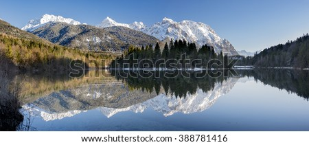 panorama landscape in Bavaria with mountains mirroring in lake - stock photo