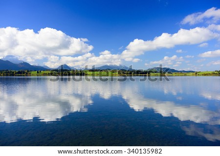 panorama landscape in Bavaria with mountains mirroring in water