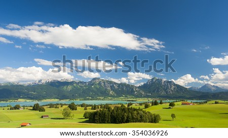 panorama landscape in germany with alps mountains and lake - stock photo