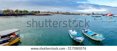 panorama landscape of marina in san cristobal galapagos islands ecuador - stock photo