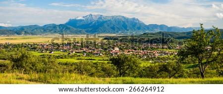 panorama landscape with bucegi mountain and vulcan village in transylvania, romania - stock photo
