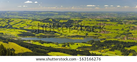 panorama landscape with lake Gruentensee in Bavaria at sunny summer day with alps mountains