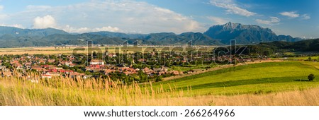 panorama landscape with vulcan village and bucegi mountain in transylvania, romania - stock photo