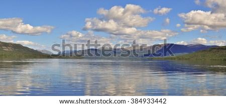Panorama mountain lakes on the Puranaa plateau. Summer landscape of the Siberian lake. - stock photo