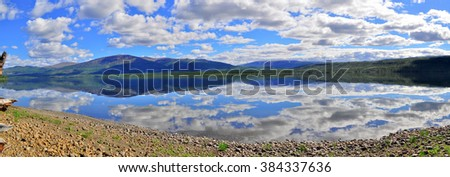 Panorama mountain lakes on the Putorana plateau. Summer landscape of the Siberian lake. - stock photo