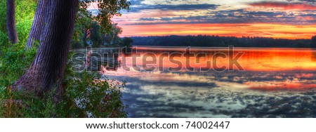 Panorama of a beautiful sunrise on a lake.