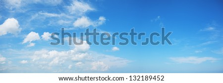 Panorama of a blue cloudy sky - stock photo