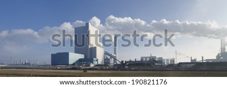 panorama of a coal fired power plant in the Rotterdam harbor area - stock photo