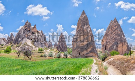 Panorama of a geological formation consisting of volcanic tuff with cave dwelling. Cappadocia in Central Anatolia is a UNESCO World Heritage Site since 1985, Turkey - stock photo