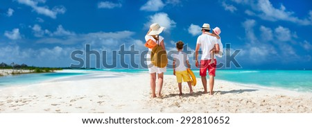 Panorama of  a happy family with kids on tropical beach vacation - stock photo