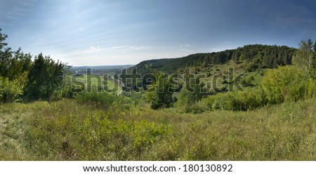 Panorama of a south german rural area in summer - stock photo