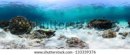Panorama of a tropical reef with rocks on a sandy bottom. Racha Yai island, Thailand - stock photo