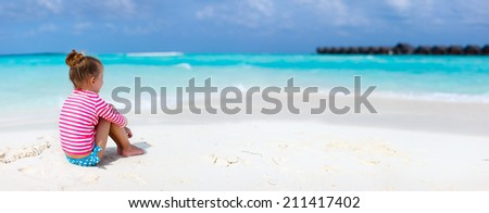 Panorama of adorable little girl at beach during summer vacation - stock photo