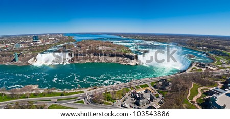 Panorama of American Falls, Bridal Veil Falls and Horseshoe Falls (Canadian Falls) collectively known as Niagara Falls on the Niagara River on the border between United States of America and Canada - stock photo