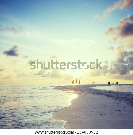 Panorama of beach on Maldives in dusk - stock photo